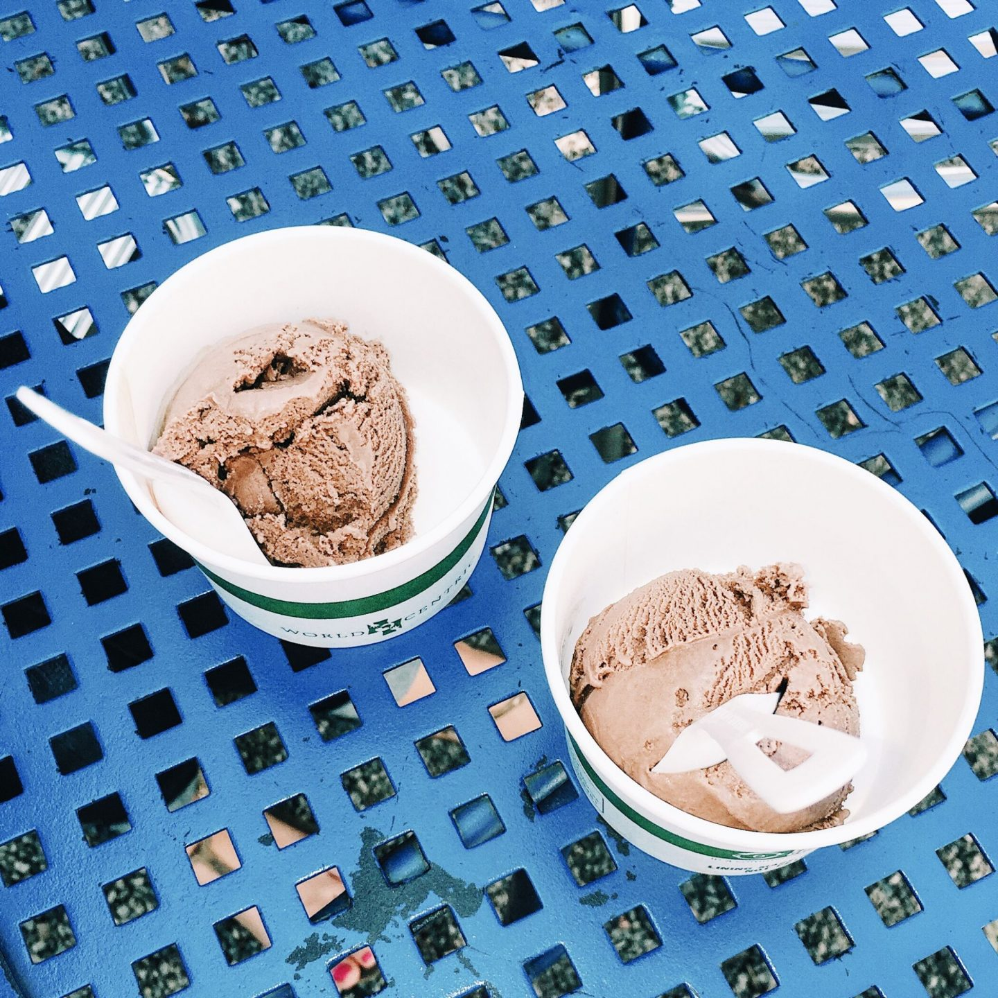 chocolate ice cream sitting on a blue table